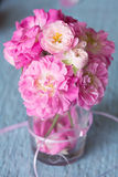 Gentle pink roses on wooden table. Shallow depth of field Royalty Free Stock Image