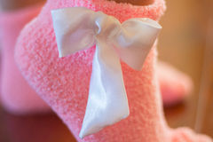 Gentle pink socks with a white bow Stock Images