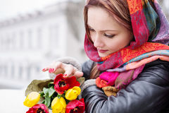Gentle portrait of a beautiful woman. With a bouquet royalty free stock image