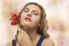 Portrait of young blond woman with flowers Stock Photography