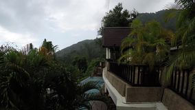 Gentle relaxing rain in Phuket , Thailand , in a jungle residence stock footage