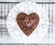 Gentle romantic valentine chocolate figures on cookie stand Stock Image