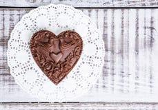Gentle romantic valentine chocolate figures on cookie stand Stock Image