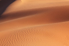 Gentle sand waves sparkle in the sun Stock Photo