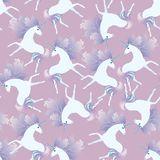 Gentle seamless pattern with cute white unicorns with mane in shape of autumn leaves on light purple background. Print for fabric. Watercolor imitation royalty free illustration