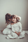 Gentle sister girls  retro, talking and hugging Royalty Free Stock Images
