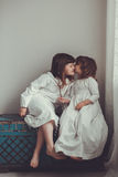 Gentle sister girls  retro, talking and hugging Stock Photo