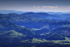 Gentle slopes with green forests in Slovak Ore Mountains Stock Photography