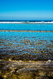 Gentle soft waves lashing onto ballybunion sandy beach Stock Image