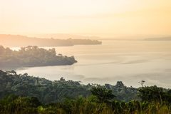 Gentle and soft yellow light at dawn over Lake Victoria royalty free stock images