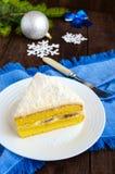 Gentle sponge cake with creamy banana layer, sprinkle coconut on top. Stock Photography