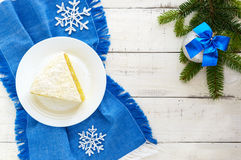 Gentle sponge cake with creamy banana layer, sprinkle coconut on top. Royalty Free Stock Images