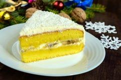 Gentle sponge cake with creamy banana layer, sprinkle coconut Royalty Free Stock Photo