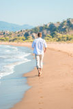 Gentle stroll along the beach barefoot Royalty Free Stock Image
