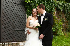 Gentle stylish couple on the background  green ivy wall, road, d Stock Photography
