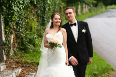 Gentle stylish couple on the background  green ivy wall, road, d Stock Photo