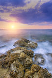 Gentle sun falling in the warm waters of summer sea Stock Image