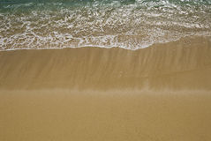 Gentle surf. Surf line on tropical beach stock photography