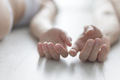 The gentle touch of hands. Couple in love, which lies on the floor naked Stock Photo