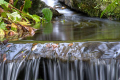 Gentle water fall in the garden. Royalty Free Stock Photo
