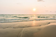 Gentle wave and clear on beach with sunset Stock Images