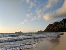 Gentle wave lap on Waimanalo Beach looking towards Rabbit island royalty free stock images
