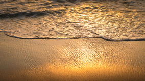 Gentle Wave Rolling over Sandbeach in Sunset light, Beautiful Crystal Bay, Nusa Penida Bali Royalty Free Stock Images