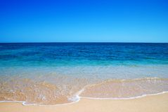 Gentle Waves. Beautiful clear mediterranean water lapping on the shore Royalty Free Stock Photo
