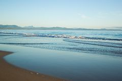 Gentle waves on the beach Royalty Free Stock Image
