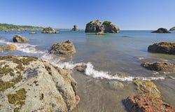 Gentle Waves on Coastal Rocks. Ocean Waves on the rocks of Trinidad Bay in California Stock Images