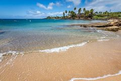 Calm tides at Poipu Beach in Kauai royalty free stock photos