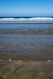 Gentle waves lashing onto ballybunion beach. Calm soft waves lashing onto ballybunion beach in county kerry ireland Royalty Free Stock Image