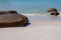 White sand beach with rocks and blue ocean Royalty Free Stock Images