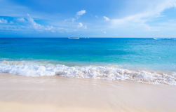 Gentle waves on the sandy beach in Hawaii. Gentle waves on the sandy Poipu beach in Hawaii, Kauai Stock Images