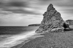 Gentle waves wash towards a sea stack. Seaham royalty free stock images