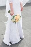 Gentle wedding bouquet. Of roses in hands of the bride luxary Stock Photography
