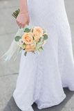 Gentle wedding bouquet. Of roses in hands of the bride luxary Stock Images