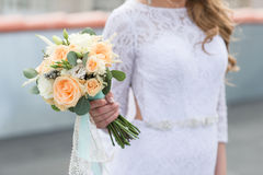 Gentle wedding bouquet. Of roses in hands of the  luxary Stock Images