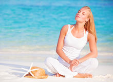 Gentle woman on the beach Stock Image