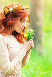 Gentle woman with wild flowers Royalty Free Stock Image