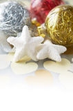 Gentle xmas baubles on holiday background Royalty Free Stock Photography