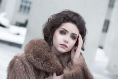 Femininity. Portrait of Sophisticated Young Brunette in Brown Fur Coat Outdoors Stock Photo