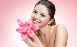Gentle young woman with flower Royalty Free Stock Photography