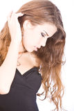 Gentle young woman touching her Stock Photography