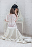 Gentlebride in negligee prepare for the wedding. Stock Photography