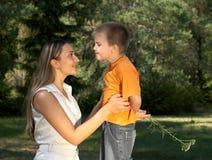 Gentleman. Little gentleman surprising his mother Royalty Free Stock Images