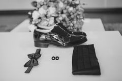 Gentleman accessories. Man's style. butterfly, shoes, sash, cufflinks. Set groom. Mobile phone. Gadget. bouquet. Gentleman accessories. Man's style. butterfly Stock Photos