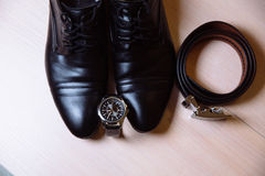 Gentleman accessory. Shoes, belt, watches Stock Photography