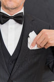 Gentleman In Black Tie Fixes Pocket Square, Vertical Royalty Free Stock Images