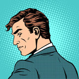Gentleman businessman looks back. Pop art retro style. A man in profile Stock Images